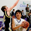Boulder's Loren Ban (right) fights past Monarch's Ryan Wilding during their basketball game at Boulder High School in Boulder, Colorado February 15, 2011.  CAMERA/Mark Leffingwell