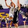Boulder's Ethan Baker (left) takes a shot while being guarded by Monarch's Ryan Wilding (right) during their basketball game at Boulder High School in Boulder, Colorado February 15, 2011.  CAMERA/Mark Leffingwell