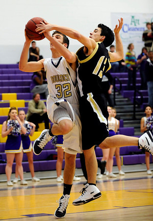 Boulder's Zack Wilson (left) is fouled by Monarch's Nathan Brooks (right) during their basketball game at Boulder High School in Boulder, Colorado February 15, 2011.  CAMERA/Mark Leffingwell