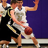 Boulder's Ethan Baker (right) blocks Monarch's Isaac Spence (left) during their basketball game at Boulder High School in Boulder, Colorado February 15, 2011.  CAMERA/Mark Leffingwell