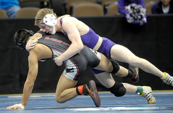 Boulder's Connor Murtha (right) gets a take down on Pomona's Raymond Robledo (left) during the first round of the 2012 State Wrestling Tournament in Denver, Colorado February 17, 2012. CAMERA/MARK LEFFINGWELL