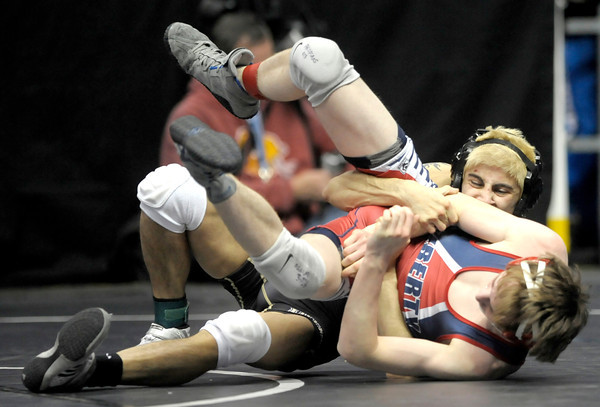 Monarch's Christian Valentine (back) rolls Liberty's Chris Fuller during the first round of the 2012 State Wrestling Tournament in Denver, Colorado February 17, 2012. CAMERA/MARK LEFFINGWELL