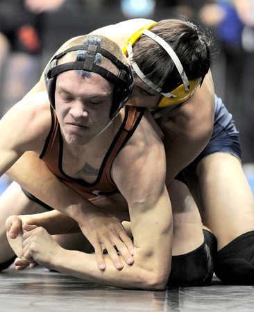 Mead's Ian Stinson (left) struggles against Olathe's Wyatt Yarnell (right) during the first round of the 2012 State Wrestling Tournament in Denver, Colorado February 17, 2012. CAMERA/MARK LEFFINGWELL