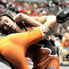 Mead's Austin Van Hooker (right) takes down Lamar's Kaleb Hansen (left) during the first round of the 2012 State Wrestling Tournament in Denver, Colorado February 17, 2012. CAMERA/MARK LEFFINGWELL