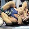 Holy Family's Kyle Spencer (back) gets a near fall on Rifles' AJ Cordova (front) during the first round of the 2012 State Wrestling Tournament in Denver, Colorado February 17, 2012. CAMERA/MARK LEFFINGWELL