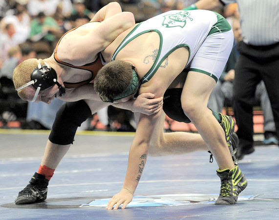Mead's Greg Rademacher (left) gets a take down on Monte Vista's Nick Maes (right) during the first round of the 2012 State Wrestling Tournament in Denver, Colorado February 17, 2012. CAMERA/MARK LEFFINGWELL