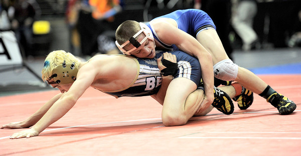 Broomfield's Jonathan Sterling (right) wrestles Palmer Ridge's Tyler Thalhammer (left) during the first round of the 2012 State Wrestling Tournament in Denver, Colorado February 17, 2012. CAMERA/MARK LEFFINGWELL