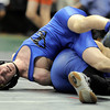 Lyons' Cameron Grossnickle (left) struggles against Custard County's Cameron Ham during the first round of the 2012 State Wrestling Tournament in Denver, Colorado February 17, 2012. CAMERA/MARK LEFFINGWELL