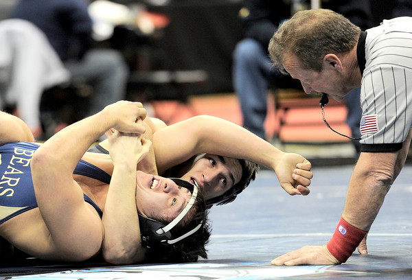 Holy Family's Kyle Spengler (back) looks to the ref as he pins Rifle's AJ Cordova (front) during the first round of the 2012 State Wrestling Tournament in Denver, Colorado February 17, 2012. CAMERA/MARK LEFFINGWELL