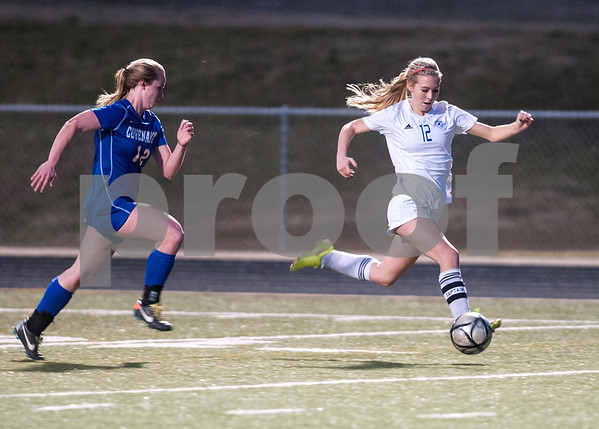 Grace Community School's Sophie Claire Rook dribbles the ball with Covenant Christian's Hannah Gooden behind her during the TAPPS Division II girls winter soccer playoffs at Grace Tuesday Feb. 12, 2016.  (Sarah A. Miller/Tyler Morning Telegraph)