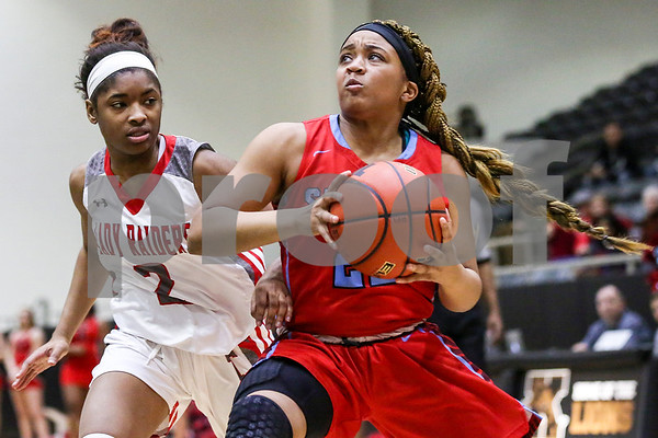 Dallas Skyline sophomore Jessica Cornelius (22), right, looks to pass the ball during a 6A Region 2 area playoff game at Kaufman High School in Kaufman, Texas, on Thursday, Feb. 16, 2017. The Dallas Skyline Raiders beat the Robert E. Lee Raiders 52-36. (Chelsea Purgahn/Tyler Morning Telegraph)