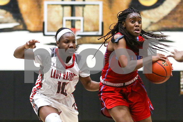 Robert E. Lee junior Tyreesha Blaylock (10) runs after Dallas Skyline senior Jaylan Gulley (1) as Gulley dribbles the ball down the court during a 6A Region 2 area playoff game at Kaufman High School in Kaufman, Texas, on Thursday, Feb. 16, 2017. The Dallas Skyline Raiders beat the Robert E. Lee Raiders 52-36.  (Chelsea Purgahn/Tyler Morning Telegraph)