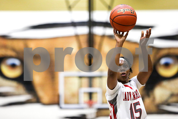 Robert E. Lee junior Ja'Kayla Bowie (15) shoots a free throw during a 6A Region 2 area playoff game at Kaufman High School in Kaufman, Texas, on Thursday, Feb. 16, 2017. The Dallas Skyline Raiders beat the Robert E. Lee Raiders 52-36. (Chelsea Purgahn/Tyler Morning Telegraph)