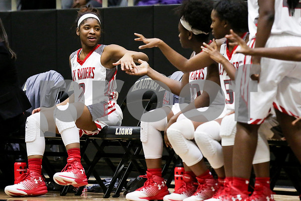 Teammates high five Robert E. Lee sophomore Heavunli Reese (2) during a 6A Region 2 area playoff game at Kaufman High School in Kaufman, Texas, on Thursday, Feb. 16, 2017. The Dallas Skyline Raiders beat the Robert E. Lee Raiders 52-36.  (Chelsea Purgahn/Tyler Morning Telegraph)