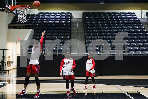 Dallas Skyline High School players warm up before a 6A Region 2 area playoff game at Kaufman High School in Kaufman, Texas, on Thursday, Feb. 16, 2017. (Chelsea Purgahn/Tyler Morning Telegraph)