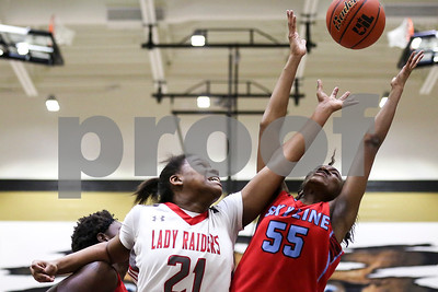 Robert E. Lee freshman Aaliyah Morgan (21) and Dallas Skyline sophomore Kyjai Miles (55) reach for the ball during a 6A Region 2 area playoff game at Kaufman High School in Kaufman, Texas, on Thursday, Feb. 16, 2017.(Chelsea Purgahn/Tyler Morning Telegraph)