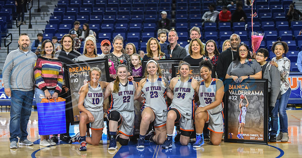 Women's basketball seniors (from left to right front row) Breana Powell (10), Samantha Odom (22), Libby Waddell (23), Jolee Carswell (34) and Bianca Valderrama (32) stand with family after being honored during Senior Day at Louise Herrington Patriot Center on Saturday, February 16. (Jessica T. Payne/Tyler Morning Telegraph)
