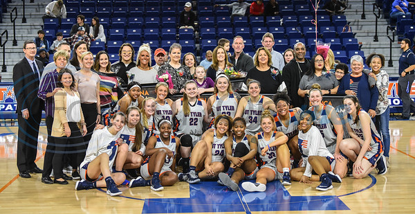 The University of Texas Tyler women's basketball team smiles for a photo with family of seniors during Senior Day at the Louise Herrington Patriot Center. Senior were honored between games on Saturday, February 16. (Jessica T. Payne/Tyler Morning Telegraph)
