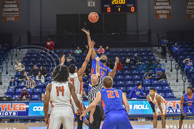Patriot junior Omar Mohamed (4) and Devon Washington (52) of Louisiana College jump for the ball during tip off on Saturday, February 16. The Patriots hosted Louisiana College at the Louise Herrington Patriot Center. (Jessica T. Payne/Tyler Morning Telegraph)