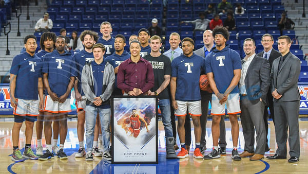 The University of Texas Tyler men's basketball team stand with coaches and senior Cam Frank who was honored during Senior Day at the Louise Herrington Patriot Center on Saturday, February 16. The team went on to play Louisiana College after the celebration. (Jessica T. Payne/Tyler Morning Telegraph)