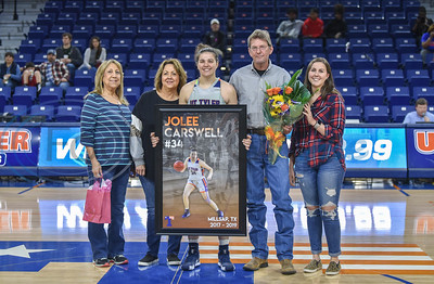 Jolee Carswell (34) smiles for a photo with family on Senior Day. Seniors were honored between the women's and men's basketball game, both against Louisiana College, at the Louise Herrington Patriot Center on Saturday, February 16.  (Jessica T. Payne/Tyler Morning Telegraph)