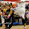 Longmont's Marcus Donaldson (right) gets the ball knocked from his hands by Silver Creek's Jake Machmuller (left) during their basketball game at Longmont High School in Longmont, Colorado February 17, 2011.  CAMERA/Mark Leffingwell