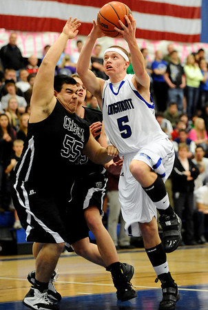 Longmont's Josh Cogdill (right) gets past Silver Creek's Ben Wooching (left) during their basketball game at Longmont High School in Longmont, Colorado February 17, 2011.  CAMERA/Mark Leffingwell