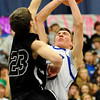 Silver Creek's Jake Machmuller (left) fouls Longmont's Cade Kloster (right) during their basketball game at Longmont High School in Longmont, Colorado February 17, 2011.  CAMERA/Mark Leffingwell