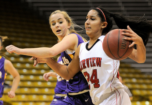 Boulder's Jacqueline Szarmach (left) fouls Fairview's Sonia Ghosh (right) during their basketball game at the University of Colorado in Boulder, Colorado February 17, 2012. CAMERA/MARK LEFFINGWELL
