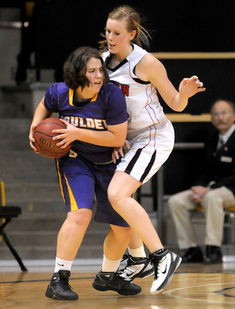 Fairview's Hannah Hyde (right) pressures Vivi Gregorich (left) Boulder's during their basketball game at the University of Colorado in Boulder, Colorado February 17, 2012. CAMERA/MARK LEFFINGWELL