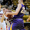 Boulder's Cara Aschbacher (right) fouls Fairview's Katie Kuosman (left) during their basketball game at the University of Colorado in Boulder, Colorado February 17, 2012. CAMERA/MARK LEFFINGWELL