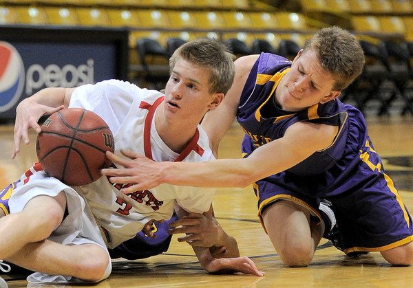 Fairview's Brent Wrapp (left) and Boulder's Jack Huettel (right) fight for a loose ball during their game at the University of Colorado in Boulder, Colorado February 17, 2012. CAMERA/MARK LEFFINGWELL
