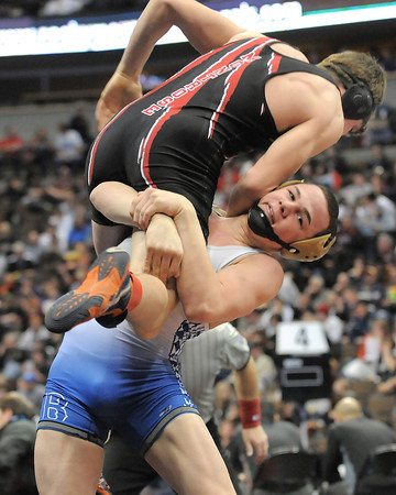 Broomfield High School's Phil Downing lifts  Montrose High School's Kordell Bradshaw in a 138 lbs 4A match during the semi-final rounds of the 2012 State Wrestling Tournament Friday  at the Pepsi Center in Denver.<br /> February 17, 2012<br /> staff photo/ David R. Jennings
