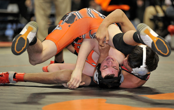 20120217_WRS_082.jpg Erie High School's Brandon Wetsch struggles to keep from being pinned by Montrose High School's Jeremiah Banuelos in a 120 lbs 4A match during the semi-final rounds of the 2012 State Wrestling Tournament Saturday, Feb. 17, 2012 at the Pepsi Center in Denver.<br /> (Matthew Jonas/Times-Call)