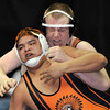 Mead High School's Nick Testroet, right, wrestles Lamar High School's Hector Morales in a 285 lbs 3A match during the semi-final rounds of the 2012 State Wrestling Tournament Saturday, Feb. 17, 2012 at the Pepsi Center in Denver. <br /> (Matthew Jonas/Times-Call)