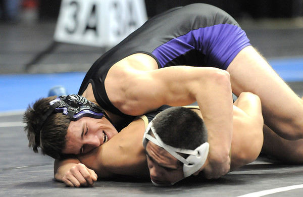 Holy Family High School's Kyle Spengler wrestles Valley High School's Austin Trujillo in a 170 lbs 3A match during the semi-final rounds of the 2012 State Wrestling Tournament Friday  at the Pepsi Center in Denver.<br /> February 17, 2012<br /> staff photo/ David R. Jennings