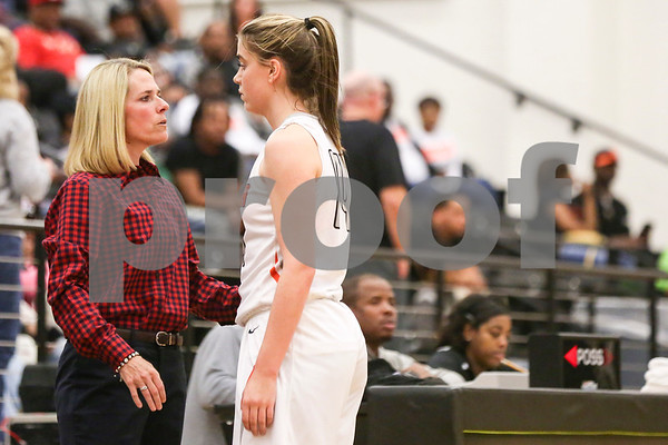 Gilmer head coach Mandi Simpson talks with junior Augusta Hampton (14) during a region 2 4A area championship girls basketball game at Winona High School in Winona, Texas, on Friday, Feb. 17, 2017. The Gilmore Lady Buckeyes beat the Brownsboro Bearettes 58-33. (Chelsea Purgahn/Tyler Morning Telegraph)