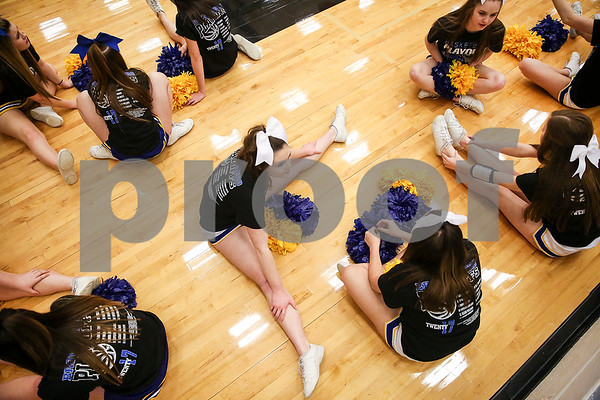 Brownsboro cheerleaders stretch before region 2 4A area championship girls basketball game at Winona High School in Winona, Texas, on Friday, Feb. 17, 2017. The Gilmore Lady Buckeyes beat the Brownsboro Bearettes 58-33. (Chelsea Purgahn/Tyler Morning Telegraph)