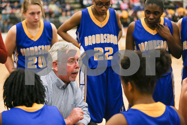 Brownsboro head coach Frederic Griffin talks to his team during a timeout during a region 4A area championship girls basketball game at Winona High School in Winona, Texas, on Friday, Feb. 17, 2017. The Gilmore Lady Buckeyes beat the Brownsboro Bearettes 58-33. (Chelsea Purgahn/Tyler Morning Telegraph)