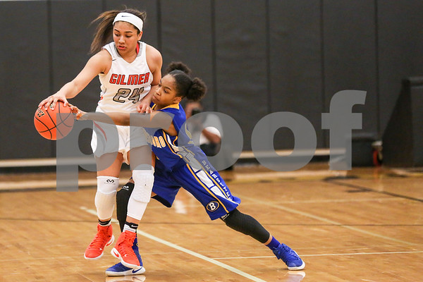 Gilmer senior Destiny Brooks (24) tries to maintain control of the ball as Brownsboro junior Aleiah Williams (11) reaches for the ball during a region 2 4A area championship girls basketball game at Winona High School in Winona, Texas, on Friday, Feb. 17, 2017. The Gilmore Lady Buckeyes beat the Brownsboro Bearettes 58-33. (Chelsea Purgahn/Tyler Morning Telegraph)