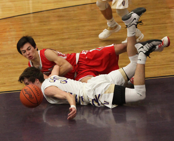 Mason Montgomery of Vermilion and Joey Harkelroad of Huron dive after a loose ball in the second quarter. Randy Meyers -- The Morning Journal