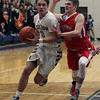 Vermilion's Drew Dawson drives by Michael Hurst of Huron during the first quarter. Randy Meyers -- The Morning Journal