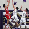 Huron's Joey Harkelroad shoots over Joby Pfeil and Mason Montgomery of Huron in the second quarter. Randy Meyers -- The Morning Journal