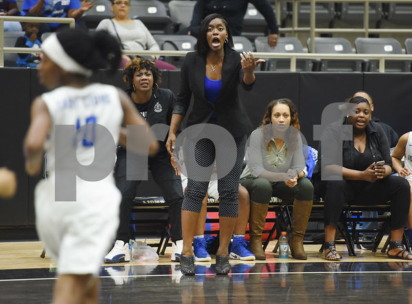 John Tyler girls' basketball team coach Carlesa Dixon talks to her players during their area playoff game against Lakeview Centennial Friday night Feb. 17, 2017 at Kaufman High School. The Lions won 63-56.  (Sarah A. Miller/Tyler Morning Telegraph)