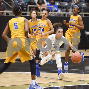 John Tyler's Destini Whitehead dribbles the ball in the fourth quarter of their area playoff game against Lakeview Centennial Friday night Feb. 17, 2017 at Kaufman High School. The Lions won 63-56.  (Sarah A. Miller/Tyler Morning Telegraph)