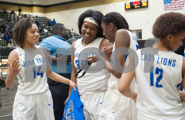 John Tyler girls' basketball team players celebrate after their area playoff win against Lakeview Centennial Friday night Feb. 17, 2017. The Lions won 63-56.  (Sarah A. Miller/Tyler Morning Telegraph)