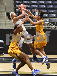 Lakeview Centennial's (23) Bre'Asiajah Mathews and (21) Cameron Wilson try to stop John Tyler's Alyssa Mayfield from reaching the basket during the area playoff game Friday night Feb. 17, 2017 at Kaufman High School. The Lions won 63-56.  (Sarah A. Miller/Tyler Morning Telegraph)
