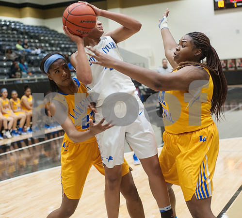 John Tyler's Alyssa Mayfield is caught between Lakeview Centennial's (23) Bre'Asiajah Mathews and (42) Jiliane Faciane during the girls' basketball team area playoff game Friday night Feb. 17, 2017 at Kaufman High School. The Lions won 63-56.  (Sarah A. Miller/Tyler Morning Telegraph)