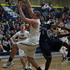 Lorain's Octavius Wilson battles Dakota Duesler of North Ridgeville for a rebound during the third quarter. Randy Meyers -- The Morning Journal