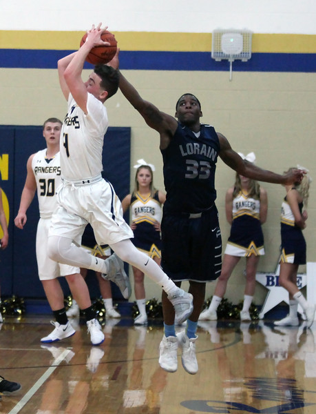 Jeremy Sanchez of North Ridgeville and Naz Bohannon of Lorain go after a long inbound pass during the first quarter. Randy Meyers -- The Morning Journal